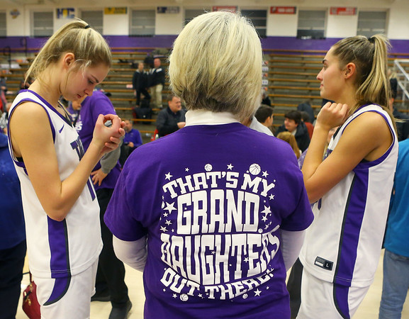 "Joyce Wise stands with her granddaughters McKenna Layden, left, and Madison Layden after the game on Grandparents night at Northwestern on Dec. 10. Joyce and Dave Wise took white tape to add an ""S"" to granddaughter on the back of their shirts, since both of their granddaughters are on the team this year.<br /> Kelly Lafferty Gerber 
