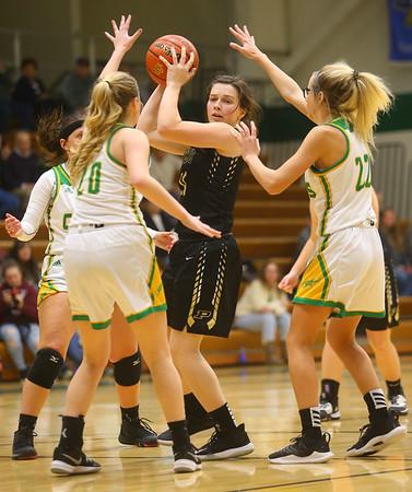 1-30-20<br /> Eastern vs Peru girls basketball<br /> Peru's Courtlynn Crowe looks for a pass through Eastern's defense.<br /> Kelly Lafferty Gerber | Kokomo Tribune