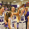 1-24-20<br /> Northwestern vs Benton Central girls basketball Hoosier conference<br /> Northwestern seniors from left: Kendall Bostic, Kate Miller, Madison Layden, Klair Merrell, and Sarah Heaver celebrate with the trophy.<br /> Kelly Lafferty Gerber | Kokomo Tribune