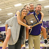 Sisters McKenna and Madison Layden hop on the backs of their parents Kathie and Jeff Layden as they pose for a photo with the trophy from the Hoosier Conference Championship win on Jan. 24.<br /> Kelly Lafferty Gerber | Kokomo Tribune