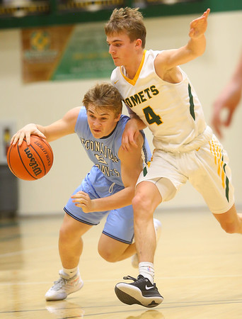 1-7-20<br /> Eastern vs Maconaquah boys basketball<br /> Mac's Nate Harding looks to get around Eastern's Matt Arcari.<br /> Kelly Lafferty Gerber | Kokomo Tribune