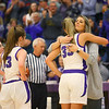 Head coach Kathie Layden hugs her daughter, Madison Layden, as Madison and the rest of the Northwestern seniors are given a standing ovation by the crowd on their last home game of the season on Jan. 24.<br /> Kelly Lafferty Gerber | Kokomo Tribune