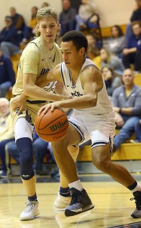 1-3-20<br /> Western vs Oak Hill boys basketball<br /> Western's Nathaniel Liddell takes the ball to the basket.<br /> Kelly Lafferty Gerber | Kokomo Tribune