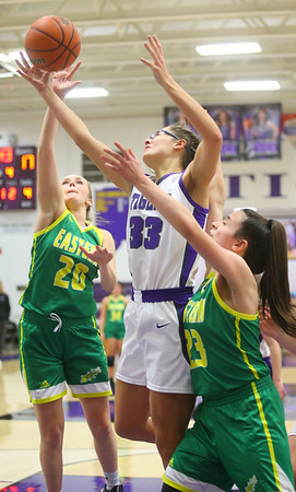1-8-20<br /> Northwestern vs Eastern girls basketball<br /> NW's Madison Layden goes after a rebound with Eastern's Kaylee Weeks and Kara Otto.<br /> Kelly Lafferty Gerber | Kokomo Tribune
