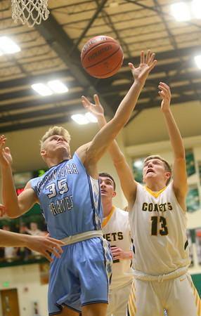 1-7-20<br /> Eastern vs Maconaquah boys basketball<br /> Mac's Kolson Silcox and Eastern's Evan Monize go after a rebound.<br /> Kelly Lafferty Gerber | Kokomo Tribune