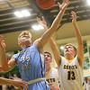 1-7-20<br /> Eastern vs Maconaquah boys basketball<br /> Mac's Kolson Silcox and Eastern's Evan Monize go after a rebound.<br /> Kelly Lafferty Gerber   Kokomo Tribune