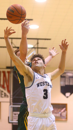 1-25-20<br /> Western vs Eastern boys basketball<br /> Western's Avery Hayes goes after a rebound.<br /> Kelly Lafferty Gerber | Kokomo Tribune