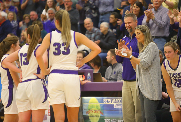 Jeff and Kathie Layden applaud the Northwestern Tigers seniors as the crowd gives them a standing ovation during their last home game of the season on Jan. 24.<br /> Kelly Lafferty Gerber | Kokomo Tribune
