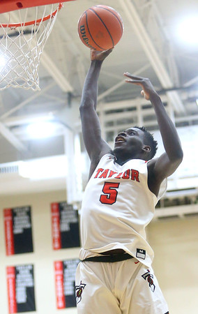 1-17-20<br /> Taylor vs CC boys basketball<br /> Taylor's Toric Spires puts up a shot.<br /> Kelly Lafferty Gerber | Kokomo Tribune