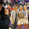 Photographer Mike Wise, Kathie's brother, takes a photo of Kathie, Madison, McKenna, and Kathie and Mike's mom Joyce Wise after the Tigers win the Hoosier Conference Championship on Jan. 24.<br /> Kelly Lafferty Gerber | Kokomo Tribune