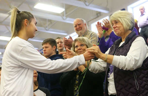 Senior Madison Layden walks up the stands to hand a flower to her grandmother, Joyce Wise, after Madison was honored during an emotional senior day for the Tigers at Northwestern High School on Jan. 11.<br /> Kelly Lafferty Gerber | Kokomo Tribune