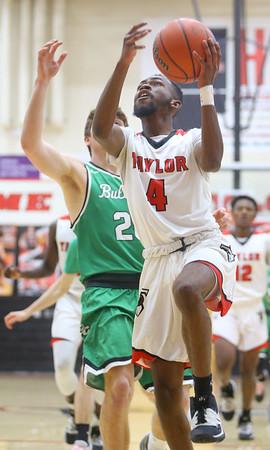 1-17-20<br /> Taylor vs CC boys basketball<br /> Taylor's Jaylin Reece shoots.<br /> Kelly Lafferty Gerber | Kokomo Tribune