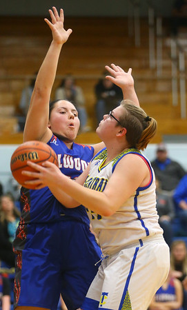 1-22-20<br /> Tri Central vs Elwood girls basketball<br /> Tri Central's #44 looks up for a shot.<br /> Kelly Lafferty Gerber | Kokomo Tribune