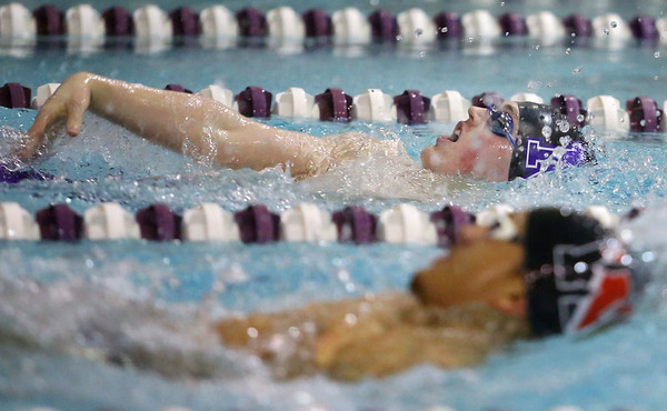 1-28-20<br /> Northwestern vs Western swimming<br /> NW's Austin Huskey, back swim against Western's Palmer Harrell in the boys 200 yard IM.<br /> Kelly Lafferty Gerber | Kokomo Tribune