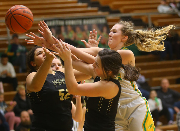 1-30-20<br /> Eastern vs Peru girls basketball<br /> Eastern's Kaylee Weeks goes for a rebound.<br /> Kelly Lafferty Gerber | Kokomo Tribune