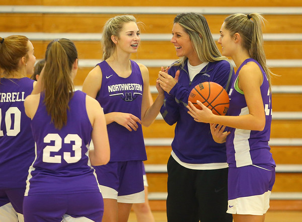 Head coach Kathie Layden laughs with the team with her daughters McKenna, left, and Madison by her side during practice on Dec. 17.<br /> Kelly Lafferty Gerber | Kokomo Tribune