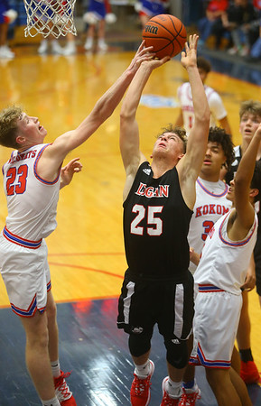 1-10-20<br /> Kokomo vs Logansport girls basketball<br /> Logansport's Garrett Barron is fouled at the basket by Kokomo's Jackson Richards.<br /> Kelly Lafferty Gerber | Kokomo Tribune