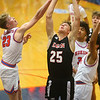 1-10-20<br /> Kokomo vs Logansport girls basketball<br /> Logansport's Garrett Barron is fouled at the basket by Kokomo's Jackson Richards.<br /> Kelly Lafferty Gerber | Kokomo Tribune