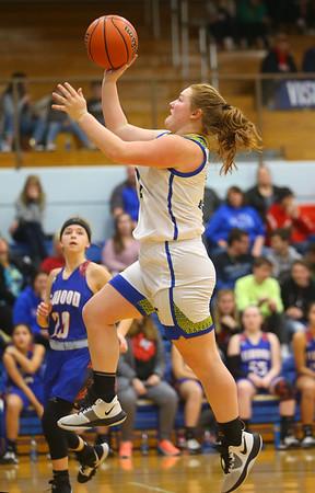 1-22-20<br /> Tri Central vs Elwood girls basketball<br /> Tri Central's Cassidy Colbert heads to the basket.<br /> Kelly Lafferty Gerber | Kokomo Tribune