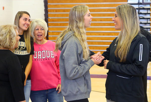McKenna Layden talks with her mom Kathie Layden in the foreground as Madison Layden laughs with her grandmother Joyce Wise, Kathie's mom, after the signing ceremony where Madison officially signed with Purdue on Nov. 13.<br /> Kelly Lafferty Gerber | Kokomo Tribune