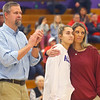 Senior Madison Layden, center, hugs her mom, Kathie Layden, as her dad Jeff applauds as Madison is honored during senior day at Northwestern High School on Jan. 11.<br /> Kelly Lafferty Gerber | Kokomo Tribune
