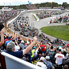 The 50 percent capacity crowd, due to covid restrictions, wave at the drivers during the parade lap before the start of the 72nd Little 500 sprint car race.
