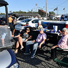 Mike Whittaker, left, enjoys tailgating with his family the afternoon of the race. Whittaker said he believes the speedway made the right call to move forward with the event.