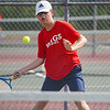 Lewis Cass' Jack Salyers goes to hit the ball while competing in the No. 1 singles match during the season opener between the Lewis Cass Kings and Logansport Berries at Lewis Cass Jr./Sr. High School in Walton on Wednesday, Aug. 18, 2021.