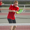 Logansport Berries' Noah Lange competes in the No. 1 singles match during the season opener between the Lewis Cass Kings and Logansport Berries at Lewis Cass Jr./Sr. High School in Walton on Wednesday, Aug. 18, 2021.