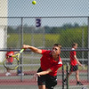 Logansport Berries' Caleb Crook competes in the No. 1 doubles match during the season opener between the Lewis Cass Kings and Logansport Berries at Lewis Cass Jr./Sr. High School in Walton on Wednesday, Aug. 18, 2021.
