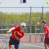 Players compete in the No. 1 singles match during the season opener between the Lewis Cass Kings and Logansport Berries at Lewis Cass Jr./Sr. High School in Walton on Wednesday, Aug. 18, 2021.