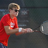 Lewis Cass' Ethan Johnson competes in #2 singles against Logansport during the first match of the tennis sectional at Logansport High School on Wednesday, Sept. 29, 2021.