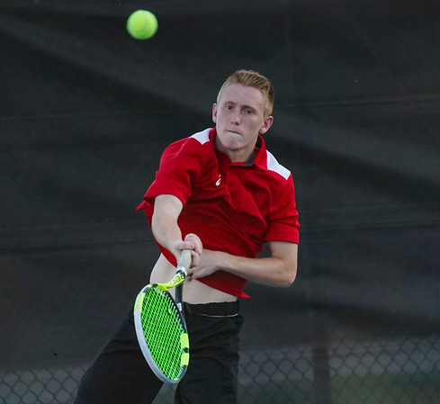 Logansport's Noah Lange competes during the first round of the tennis sectional at Logansport High School on Wednesday, Sept. 29, 2021.