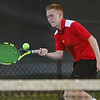 Logansport's Noah Lange hits the ball while competing against Lewis Cass in #1 singles during the first match of the tennis sectional at Logansport High School on Wednesday, Sept. 29, 2021.