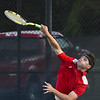 Logansport's Gavin Smith competes during the first round of the tennis sectional at Logansport High School on Wednesday, Sept. 29, 2021.