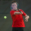 Logansport's Connor Penz hits the ball while competing in #2 singles against Lewis Cass during the first match of the tennis sectional at Logansport High School on Wednesday, Sept. 29, 2021.