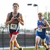 """Lewis Cass' Cole McCloskey (421) throws up a """"W"""" while competing during the Cass County cross country meet at Logansport High School on Saturday, Aug. 28, 2021. Lewis Cass finished second as a team."""