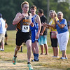 Pioneer's Jackson Baker (428) heads to the finish line during the Cass County cross country meet at Logansport High School on Saturday, Aug. 28, 2021. Baker finished second and the team finished first.