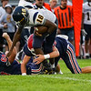 Lewis Cass Kings players tackle Delta Eagles quarterback Kaiden Bond (18) during the first half of a game between the Lewis Cass Kings and Delta Eagles at Owens Memorial Field in Walton on Friday, Sept. 3, 2021.