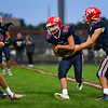 Lewis Cass Kings running back Haden McClain (30) gets the handoff during the first half of a game between the Lewis Cass Kings and Delta Eagles at Owens Memorial Field in Walton on Friday, Sept. 3, 2021.