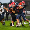 Lewis Cass Kings fullback Cooper Frey (32) finds a gap in the defense during the first half of a game between the Lewis Cass Kings and Delta Eagles at Owens Memorial Field in Walton on Friday, Sept. 3, 2021.