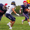 Lewis Cass Kings running back Elijah Martin (20) runs to the edge during the first half of a game between the Lewis Cass Kings and Delta Eagles at Owens Memorial Field in Walton on Friday, Sept. 3, 2021.