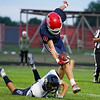 Lewis Cass Kings defensive back Keaton Lewellen (8) breaks a tackle after intercepting the ball during the first half of a game between the Lewis Cass Kings and Delta Eagles at Owens Memorial Field in Walton on Friday, Sept. 3, 2021.
