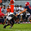 Lewis Cass Kings lineman Erick Hardy (60) and defensive end Luke Chambers (62) tackle a Delta Eagles player during the first half of a game between the Lewis Cass Kings and Delta Eagles at Owens Memorial Field in Walton on Friday, Sept. 3, 2021.