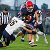 Lewis Cass Kings defensive back Keaton Lewllen (8) sheds a tackler after an interception during the first half of a game between the Lewis Cass Kings and Delta Eagles at Owens Memorial Field in Walton on Friday, Sept. 3, 2021.