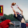 A Lewis Cass Kings cornerback attempts to make an interception during a preseason scrimmage against the Southwood Knights at Lewis Cass Jr./Sr. High School in Walton on Friday, Aug. 13, 2021.