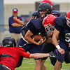 Lewis Cass Kings fullback Cooper Frey (32) runs the ball during a preseason scrimmage against the Southwood Knights at Lewis Cass Jr./Sr. High School in Walton on Friday, Aug. 13, 2021.
