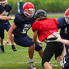 Lewis Cass Kings defensive players converge on the ball carrier during a preseason scrimmage against the Southwood Knights at Lewis Cass Jr./Sr. High School in Walton on Friday, Aug. 13, 2021.