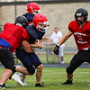 A Lewis Cass Kings player runs the ball during a preseason scrimmage against the Southwood Knights at Lewis Cass Jr./Sr. High School in Walton on Friday, Aug. 13, 2021.