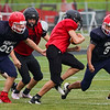 Lewis Cass Kings players chase down a ball carrier during a preseason scrimmage against the Southwood Knights at Lewis Cass Jr./Sr. High School in Walton on Friday, Aug. 13, 2021.